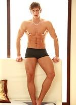 Muscled jock Joe Rivas posing naked
